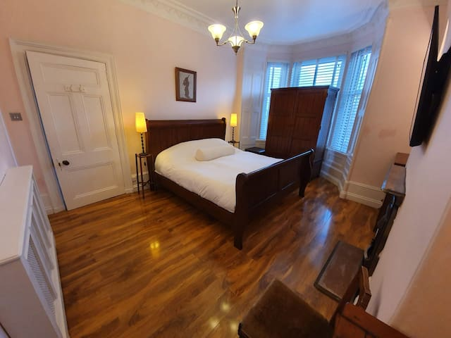 Bright super king room in large granite house