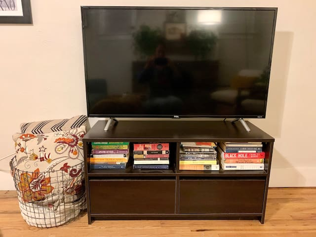 TV in the living room with access to Netflix, HBO Now, Hulu and Amazon Prime