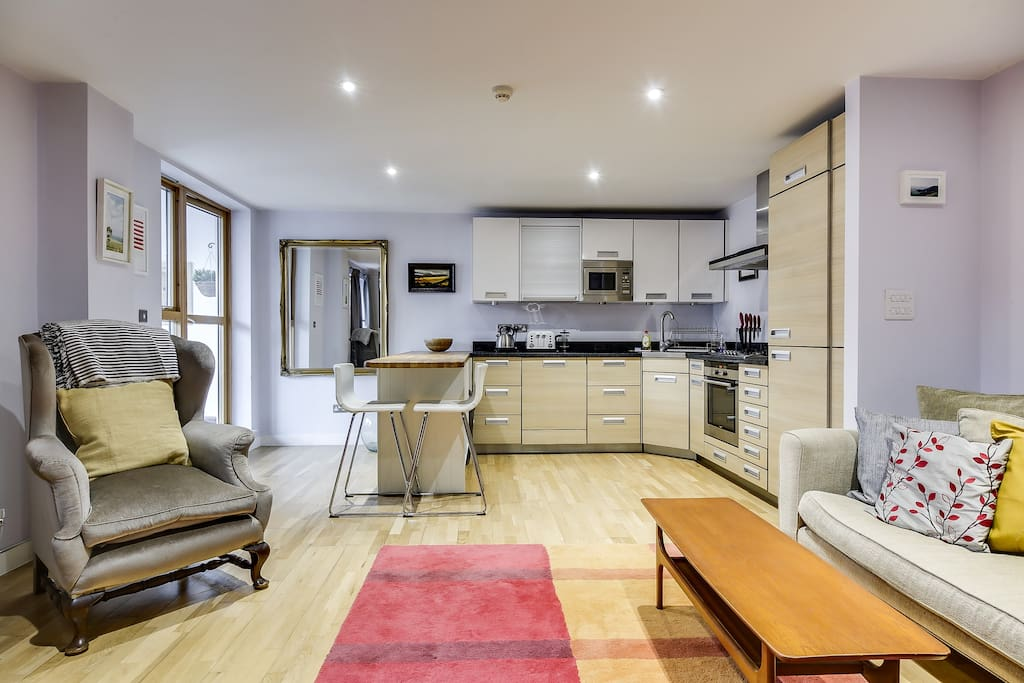 The open-plan design makes the area feel spacious and bright.