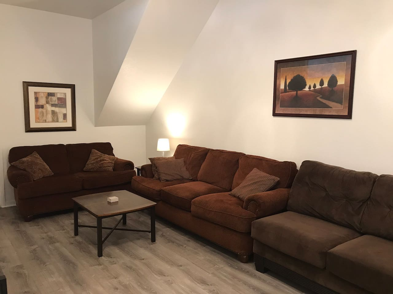 Relax on large comfy couches, under high ceilings! Wonderful amounts of space in this place!