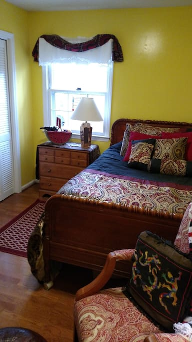 Another view of bedroom.  Huge closet, dresser, bookshelves, desk, leather desk chair, rocking chair and ottoman.