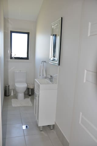 Powder room upstairs for guests convenience (there are 4 toilets in this house)