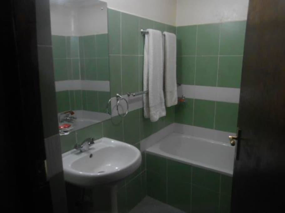 Both bathrooms have bathtub with shower