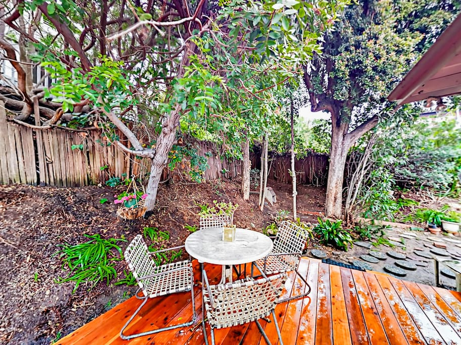 The beautiful backyard offers a lush green spot to relax and recharge.
