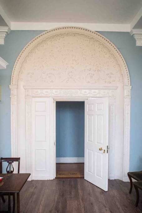 18th century papier-mâché moulding on arched doorway