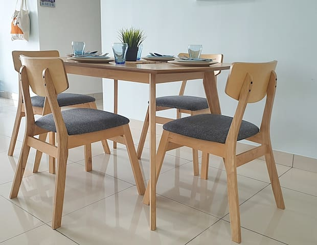 Dining Table with 4 Chairs with cutlery provided.