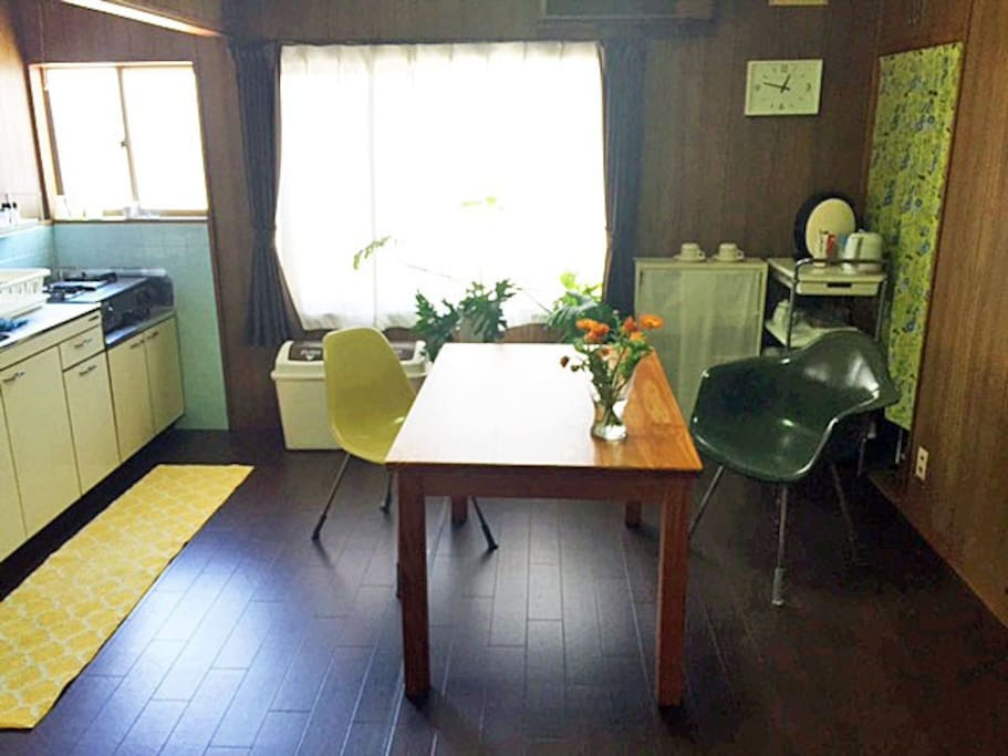 15 sq meter / 150 sq ft kitchen and dining room with original Eames' chairs on 2nd floor