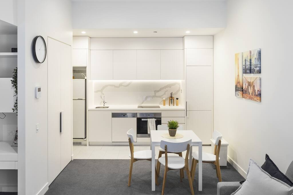 An open-concept kitchen and dining space for you and your group to enjoy meals together.