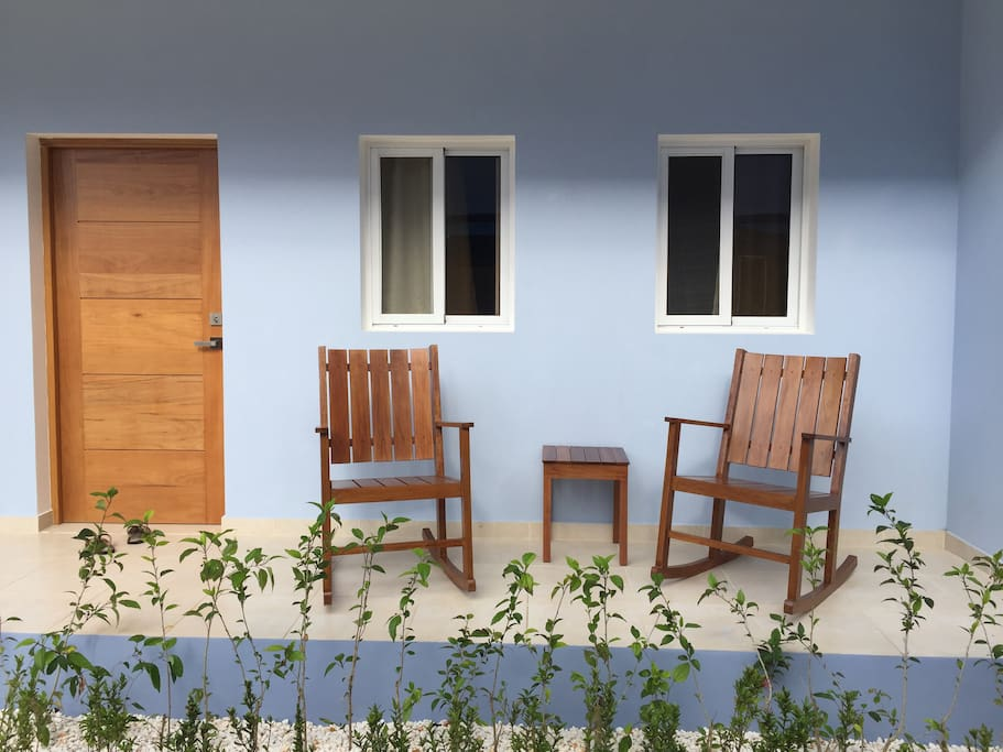 Patio with rocking chairs.