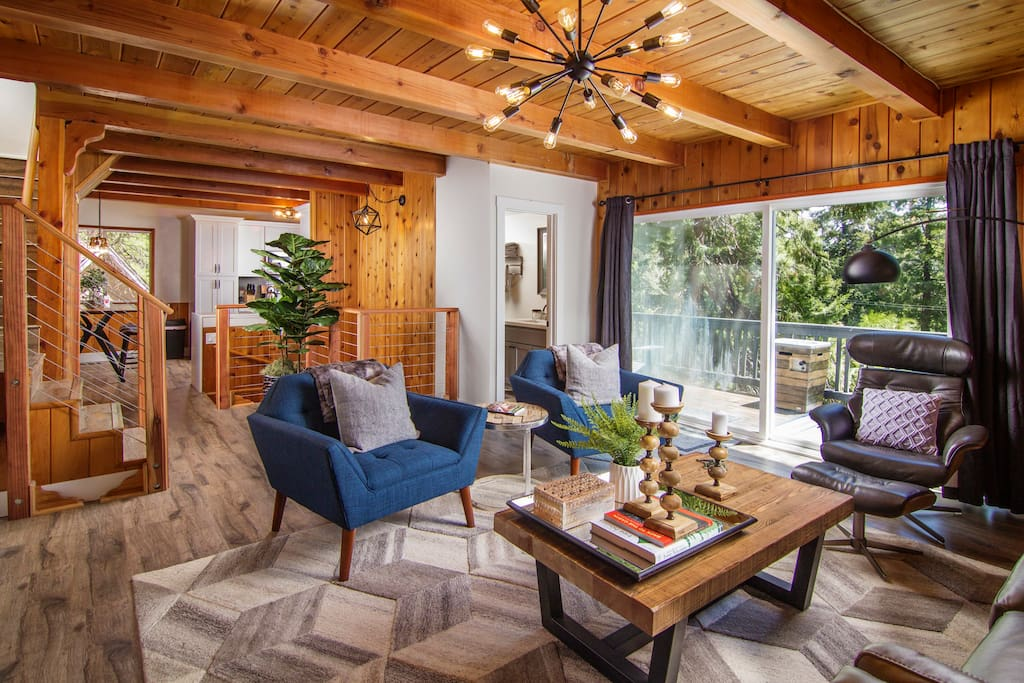 Main Level | Living room, kitchen, bath and fully appointed deck