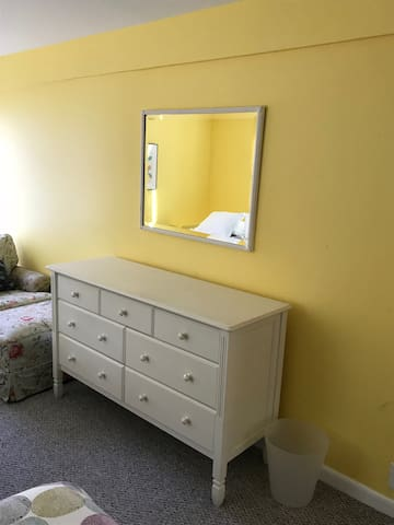 Dresser and mirror in the yellow bedroom.