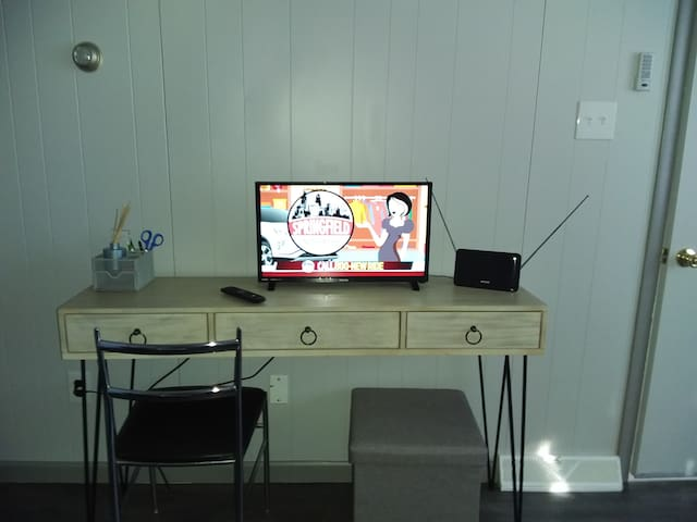 Desk and TV space in bed room.