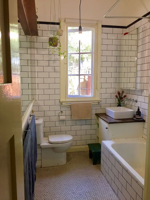 The bathroom, bath, shower over bath and toilet and the left wall is all mirror above the towels!