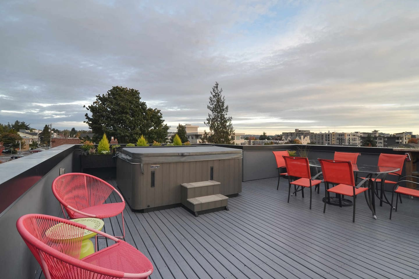 The rooftop deck with 360 degree views to Discovery Park and the City of Seattle from the relaxing 6 person hot tub.