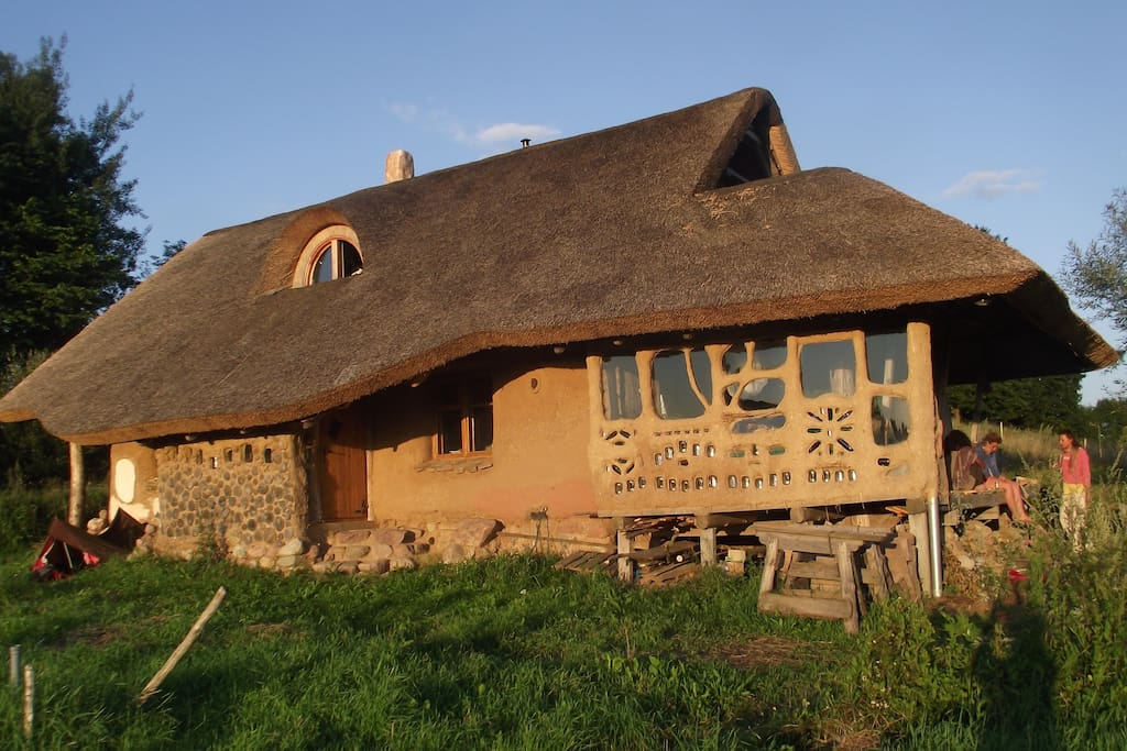 The west side of straw bale house with the ground floor terrace.