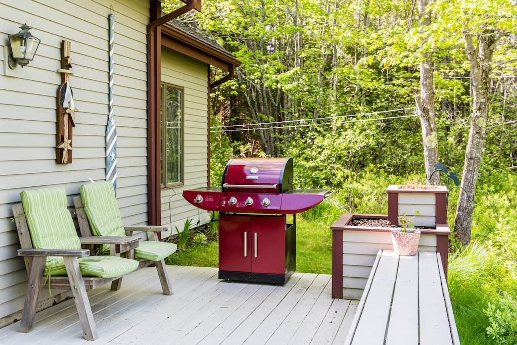 Just a small part of the large deck with picnic table, numerous seating and grill overlooking Denning Brook.