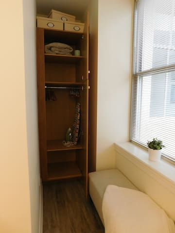 Inside Wardrobe with Iron and Ironing Board Provided