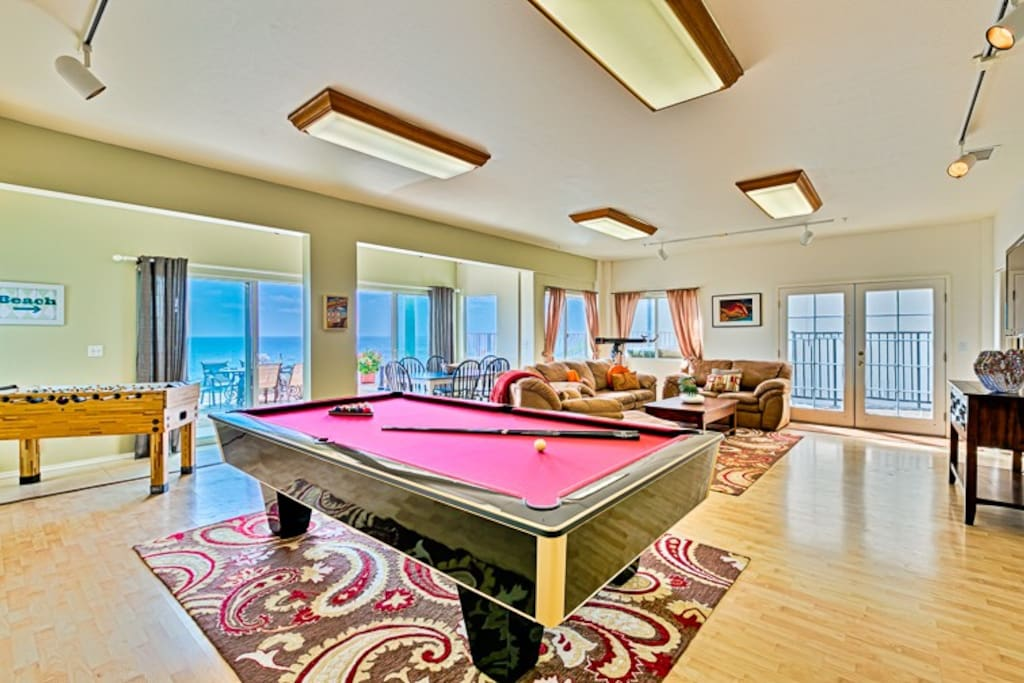 Full size 9 foot pool table. Foosball table and endless views out the window.