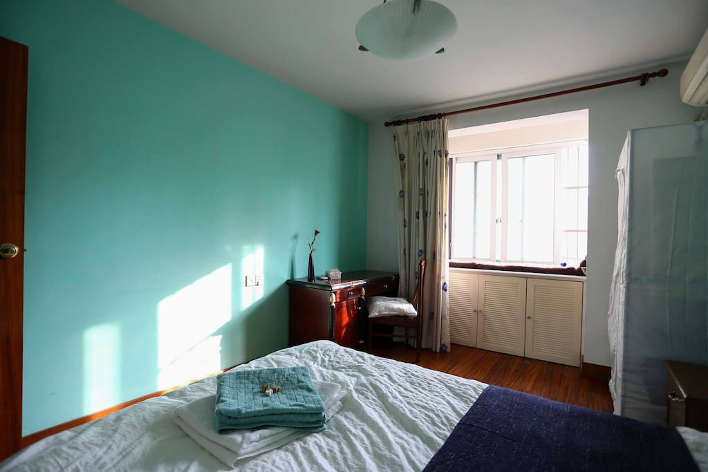 Your spacious and comfy room for your stay in our place - you'll have plenty of storage, night lamp and a desk