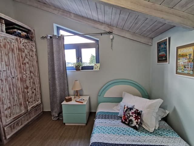 Bedroom with semi-double bed and closed wardrobe.
