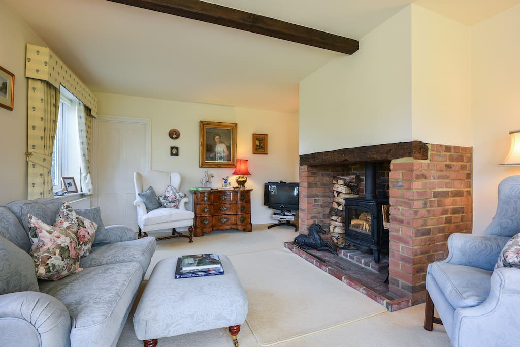 The Sitting room is equipped with a log burning stove