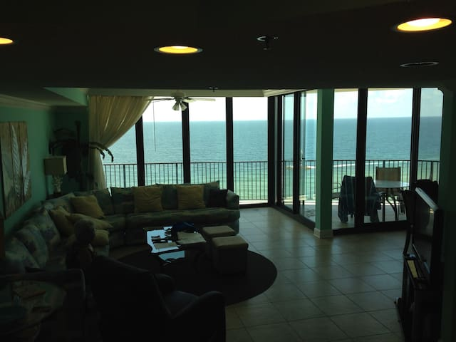 Loving room showing the balcony and gulf