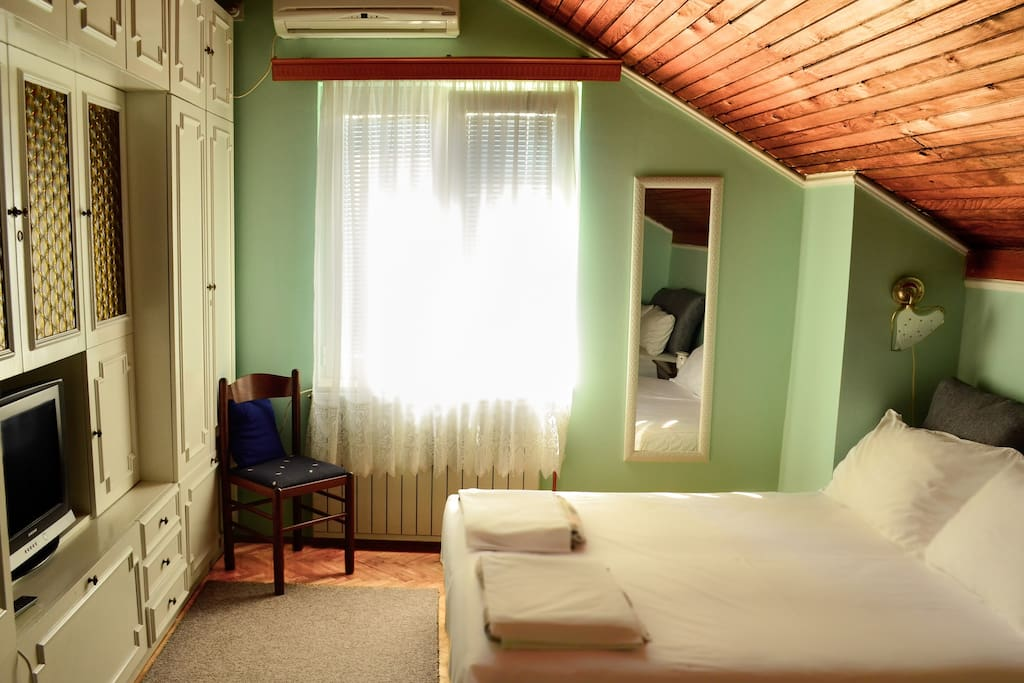 Room 1. Two double beds for up to 4 persons: cable TV, air-conditioning and heating. All rooms have a big dedicated fridge in the corridor of the house floor.