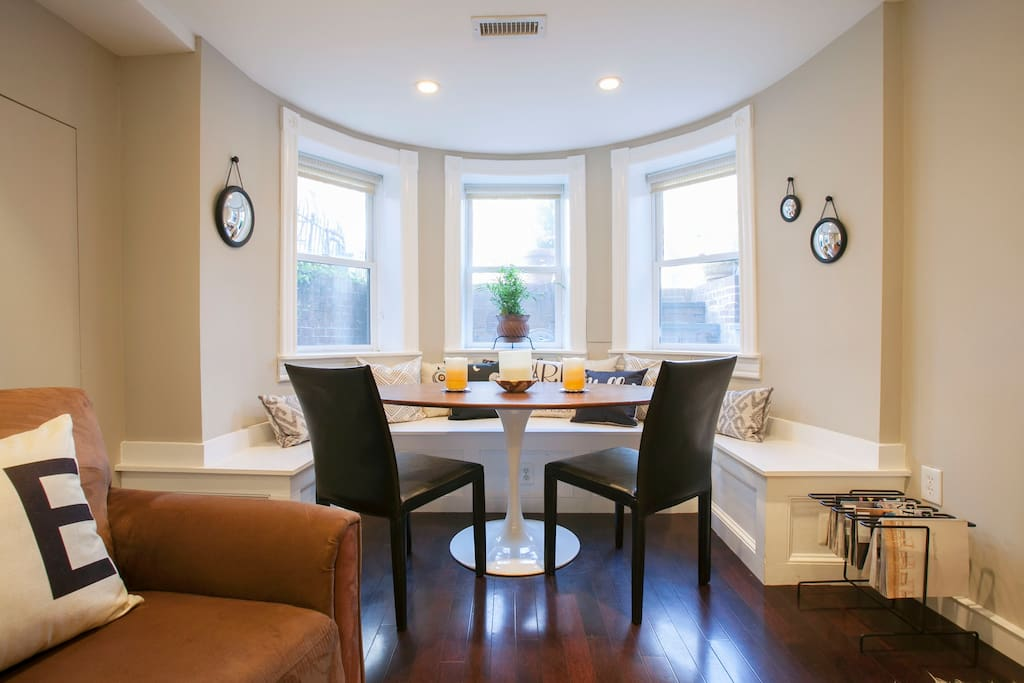 Dining area in bay window seats six. Great spot for working, too!