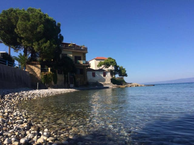 Traditional house over the sea wave - Mikri Mantineia