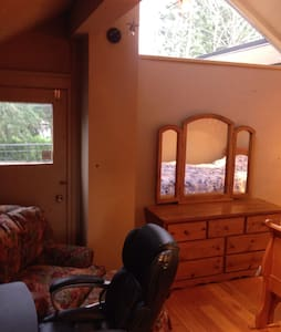 Room with vaulted ceilings & patio