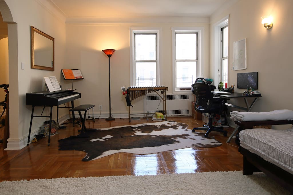 Living room/office/music space. Lots of natural light. Electric piano and vibraphone can be used, just please don't out any food or drinks on the musical instruments (...and we're a vegetarian family, so of course, that's faux-cow hide).