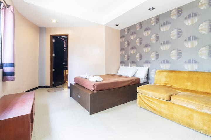 First room, or the single room, which has  one (1)  double size bed, a sofa bed, and its own comfort room.