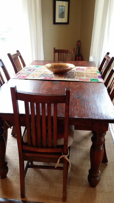 The dining area just off the kitchen is ideal for entertaining - the rustic, solid wood dining table comfortably accommodates eight.