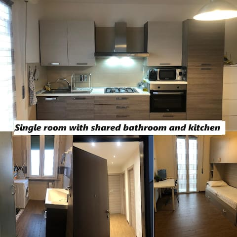 Single room with shared bathroom and kitchen