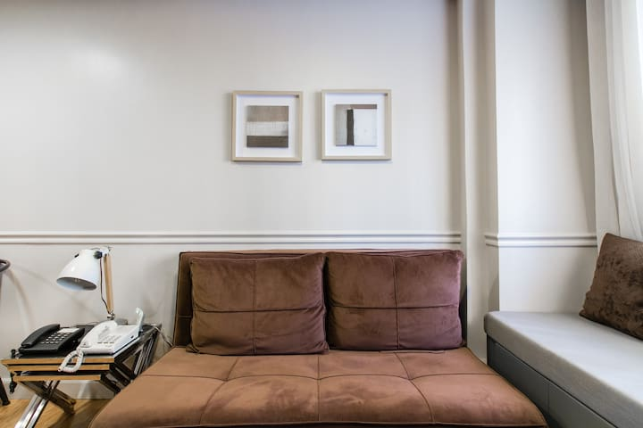 This is your home away from home.  Read a book on this cozy couch.