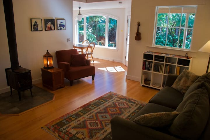 Relax and enjoy our spacious and comfortable living room with its wood burning stove, inviting furniture, open beam ceilings and beautiful hardwood floors.