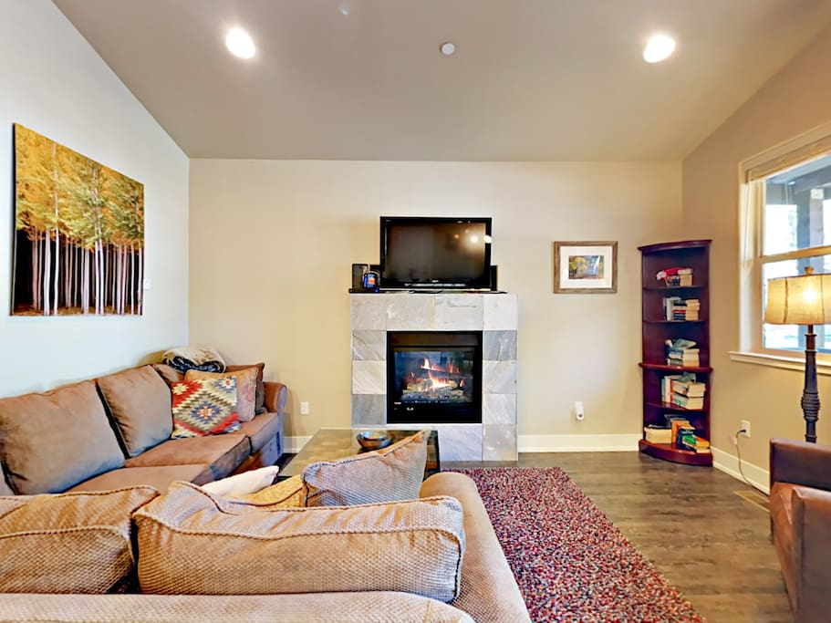 A gas fireplace anchors the spacious living room.