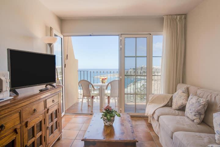 """Appartement confortable """"Granada I Apartamento 10"""" à quelques mètres de la plage avec vue sur la mer, piscine commune, connexion Wi-Fi et terrasse privée"""