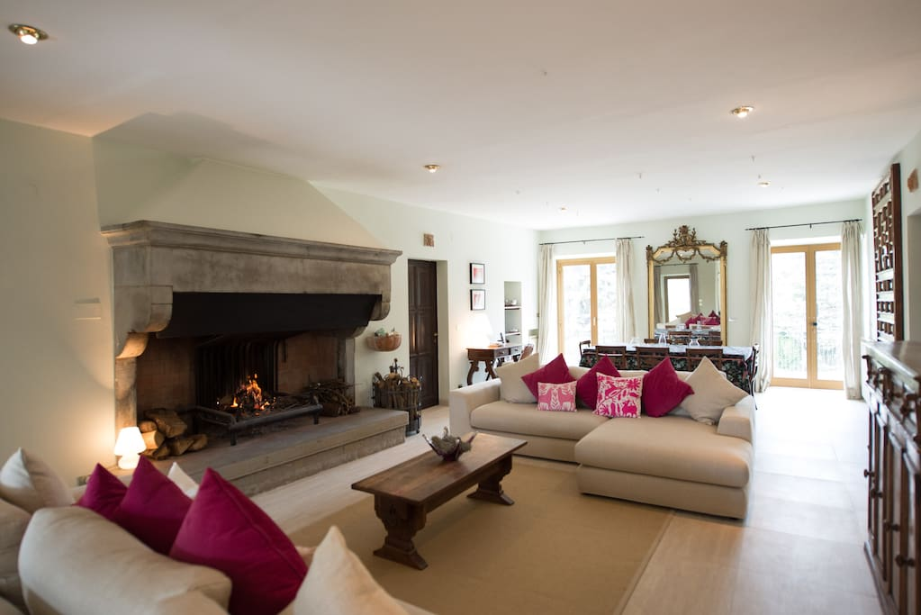 Newly renovated living room on the first floor with sweeping views over pool and surrounding mountains.