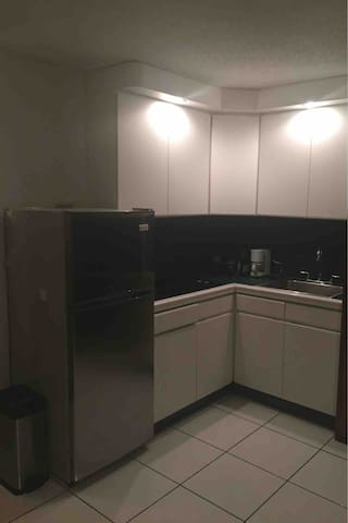 Kitchen with new refrigerator.