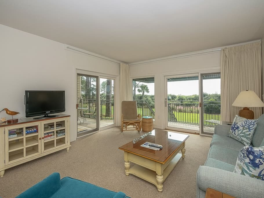 Enjoy views of the water from the living area with new furniture at 1824 Beachside Tennis