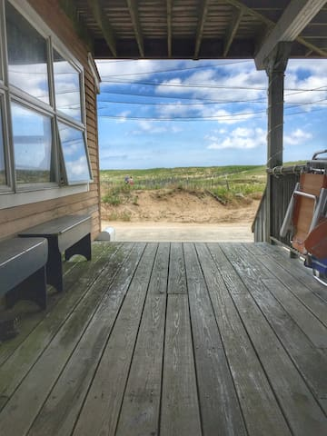 Beach front house offering first floor apartment.
