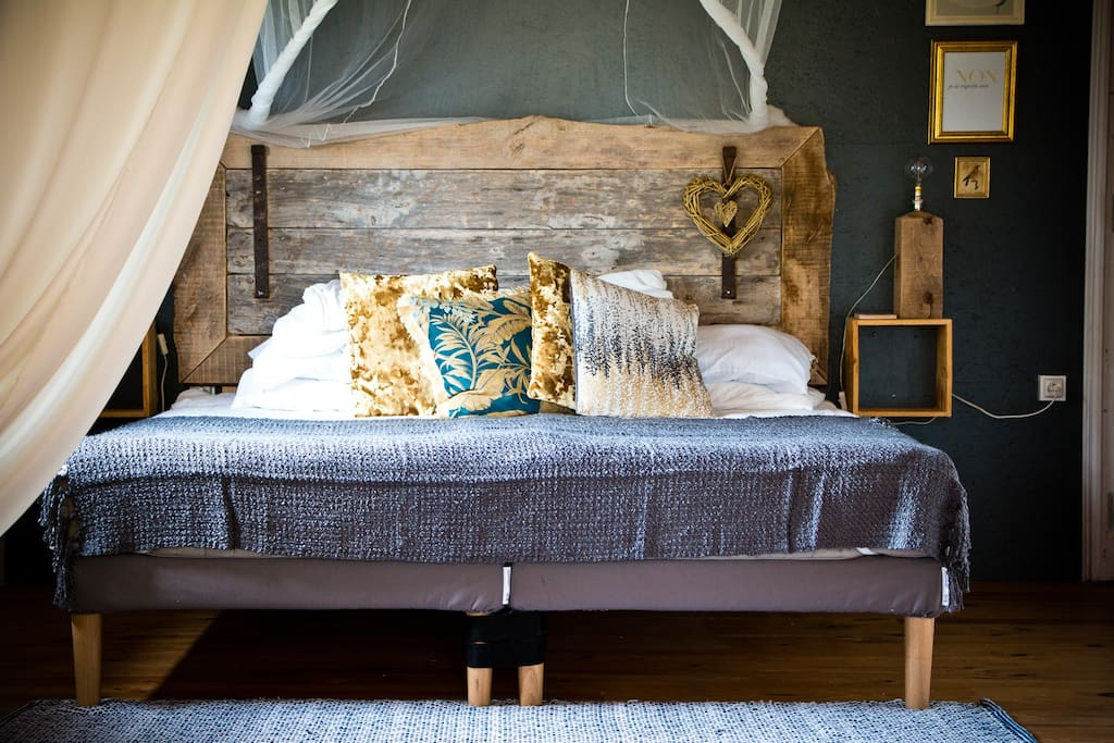 Super-king size bed with winter duvet and cosy blankets