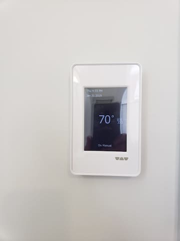 The bathroom has heated floors on a separate thermostat.