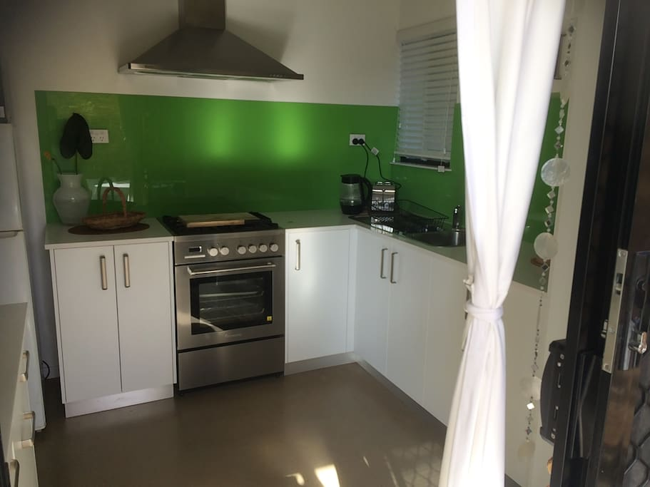 The fully self contained and equipped kitchen with gas stove and oven.