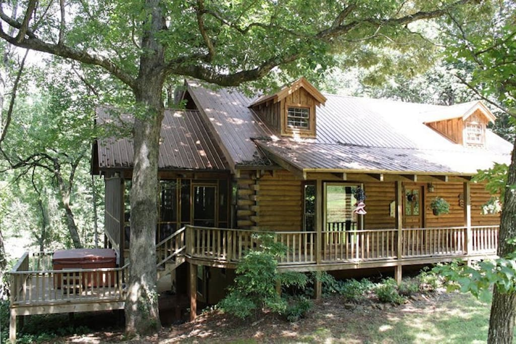 Magical log cabin on the creek with waterfall cottages for Large cabin rentals north georgia