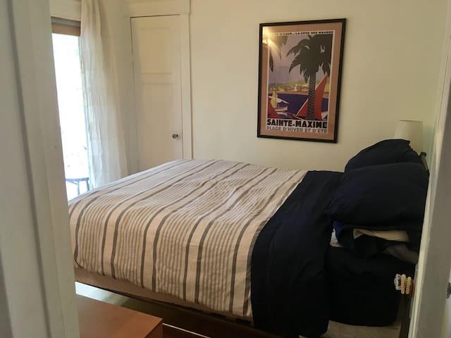Comfy queen bed in master bedroom (main floor). Has sliding door out to deck.