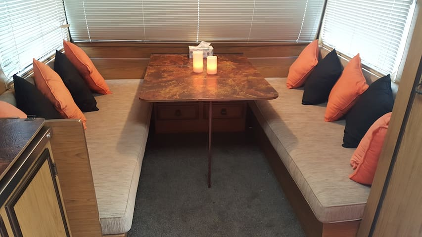 Comfortable space for eating or working. Double power outlet beside table.