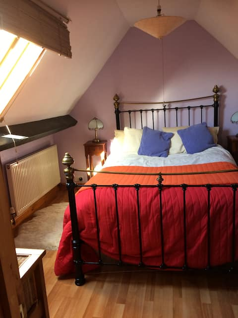 Comfortable private attic room in shared cottage