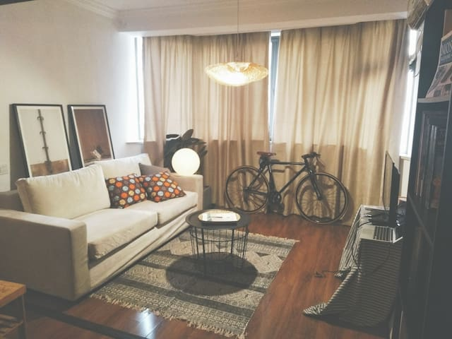 the living space is spacious for 2 , and there is a couch for people to crash